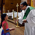 Deacon Ruben Castañeda distributes the Eucharist during Saturday Mass at Sacred Heart Church in Breckenridge, July 29, 2017.