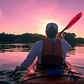 man in kayak at sunset