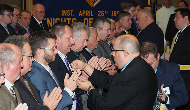 Members of the Knights of Columbus receive rosaries Jan. 1, 2020, as part of the organization's new ceremony that is designed to condense the Knights of Columbus' three degrees into one.