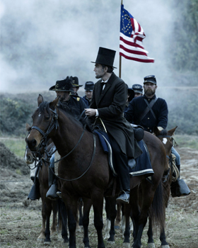 "Actor Daniel Day-Lewis portrays U.S. president Abraham Lincoln in a scene from the movie ""Lincoln."" The Catholic News Service classification is A-III -- adults. The Motion Picture Association of America rating is PG-13 -- parents strongly cautioned. Some material may be inappropriate for children under 13. (CNS/DreamWorks)"