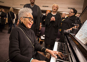 Our Mother of Mercy choir director Zenovia Collins plays a lively song at the end of the annual Martin Luther King Jr. Mass in January. (NTC/Juan Guajardo)