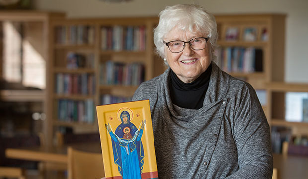 SIster Carrie Link with an icon of Mary, Undoer of Knots