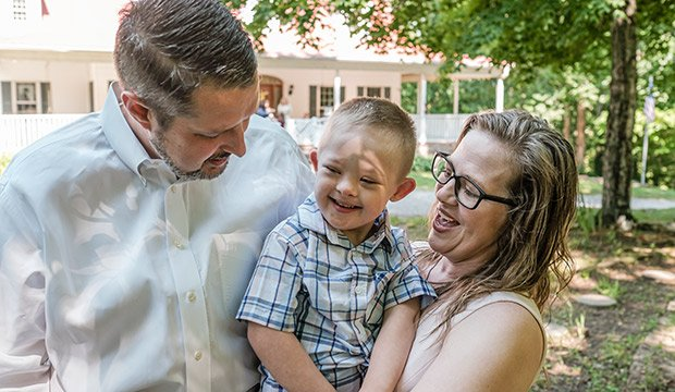 Daniel and Michelle Schachle hold their son Mikey, 5