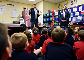 Joe Daniels, the CEO and president of the National Medal of Honor Museum, and Marc Wolf, the museum's vice president of development,, speak with elementary students at St. Joseph Catholic School in Arlington, Nov. 07, 2019.