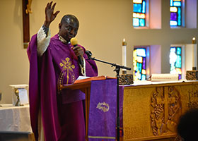 Fr. Peter Opoku-Ware celebrates Mass for the Ghana Catholic Community at St. Joseph Parish in Arlington.