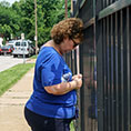 woman prays Rosary at St. Louis Planned Parenthood