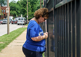 A pro-life supporter prays with her rosary outside Missouri's sole remaining Planned Parenthood clinic in St. Louis May 31, 2019. The Missouri Department of Health and Senior Services has told Planned Parenthood officials it will not renew the clinic's license when it expires unless changes are made to comply with various state health regulations. Just hours before the license expired May 31, a judge issued a temporary restraining order keeping the clinic open until June 4. (CNS photo/Lawrence Bryant, Reuters)