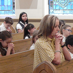 Kim Otto at Mass with students of St. Mary Catholic School