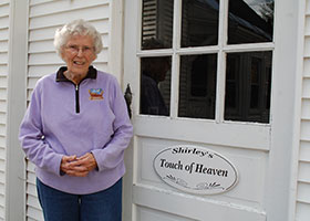 Shirley Squires of Guilford, Vt., stands outside her garage, which houses many of her Nativity sets year round.