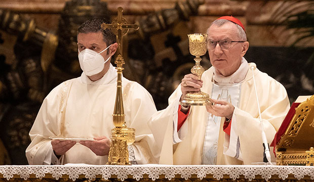 Cardinal Pietro Parolin, Vatican secretary of state, celebrates Mass on the feast of Mary, Mother of God, and Word Peace Day Jan. 1, 2021, in St. Peter's Basilica at the Vatican