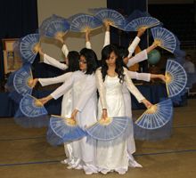Talented student performers honor Mary through a colorful Asian fan dance.