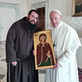 Capuchin Father Emiliano Antenucci presents an image of Our Lady of Silence to Pope Francis at the Vatican March 22, 2019.