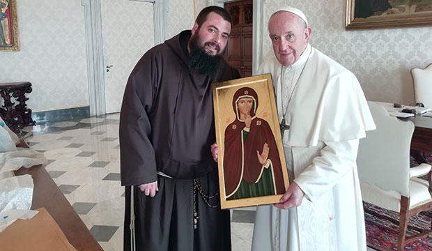 Capuchin Father Emiliano Antenucci presents an image of Our Lady of Silence to Pope Francis at the Vatican March 22, 2019