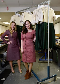 Co-founders Audrey Cole, right, CEO, and Mary Kunkel, CCO of Paris Bloom, pose with a dress titled Clemy at TLCI Manufacturing in Dallas, July 17, 2019.