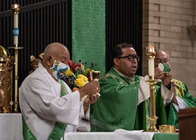 Deacon Anastasio Perez, left, Rev. Raul Martinez Lopez, and Deacon Bradley Samuelson