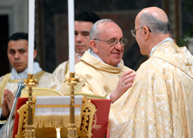 Pope Francis exchanges a sign of peace with Cardinal Tarcisio Bertone, former Vatican secretary of state, as the new pontiff celebrates Mass with cardinals in the Vatican's Sistine Chapel March 14. (CNS photo/L'Osservatore Romano)