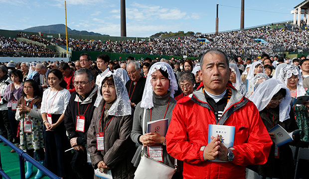 People attend Pope Francis' celebration of Mass at the baseball stadium in Nagasaki, Japan, Nov. 24, 2019. (CNS photo/Paul Haring)
