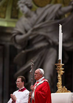 Pope Francis holds his crosier at a Pentecost Mass in St. Peter's Basilica