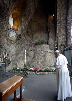 Pope prays at a replica of Lourdes grotto