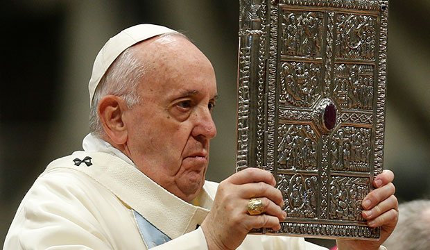 Pope Francis holds book of Gospels