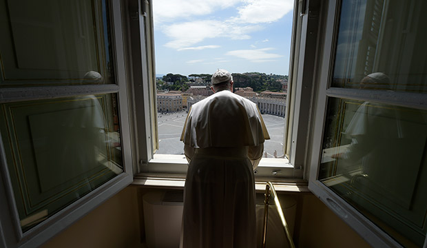 Pope Francis looks out window