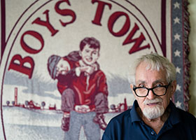 Roger Hinesh with boys town blanket