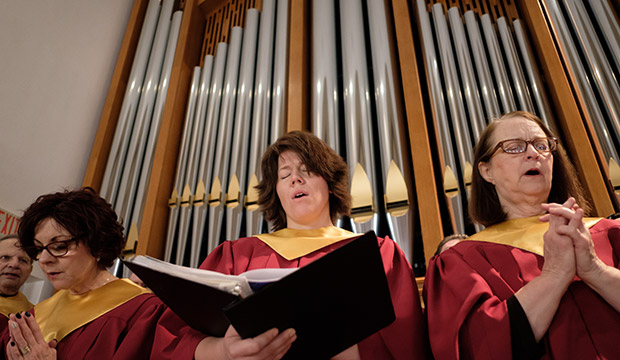 Choir members sing the 9 a.m. Mass at St. Maria Goretti Parish in Arlington on Sunday, March 3. (NTC/Kevin Batram)