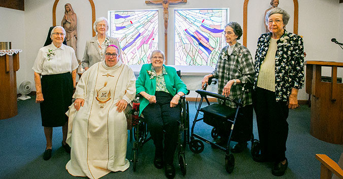 Bishop Olson with five Sisters of St. Mary of Namur