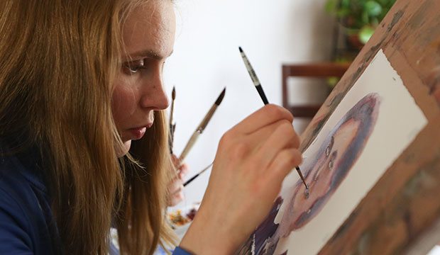 "Bernadette Gockowski works on a watercolor painting of Mother Henriette Delille May 3, 2019, at her home in St. Paul, Minn. Mother Delille lived in New Orleans in the 1800s and founded the Sisters of the Holy Family, a congregation of black sisters. She was declared venerable by Pope Benedict XVI in 2010. Gockowski decided to paint a portrait of her after researching her. ""She has an amazing story,"" Gockowski said, adding that she became a nun ""before the Civil War, when it was illegal for an African American to be a nun."" (CNS photo/Dave Hrbacek, Catholic Spirit)"