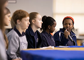 Holy Trinity Catholic School students have a panel discussion about their involvement with community service January 27.