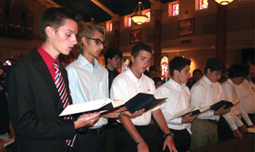 Columbian Squires stand in the front row of St. Elizabeth Ann Seton Parish in Keller during a vigil Mass held June 28. O