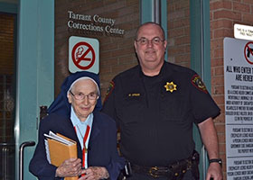 Sr. Frances Vuillemin, SSMN, with Officer Green