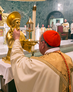 Cardinal Timothy M. Dolan of New York prays over the relic of St. Anthony of Padua as he celebrates Mass at St. Francis of Assisi Church in New York Feb. 19. Cardinal Dolan celebrated one of several Masses honoring St. Anthony of Padua, a Franciscan fria r known for his gifted preaching who died in Italy in 1231. The relics will be on display in New York and New Jersey before returning to Padua, Italy. (CNS photo/Octavio Duran)