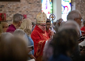 Bishop Michael Olson greets parishioners at the beginning of the 50th Anniversary Mass at St. Bartholomew Catholic Church on August 24, 2019.
