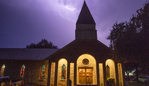 Storms move through the area as Saint Rose of Lima Catholic Church in Glen Rose, prays the Rosary, celebrates Mass and enjoys a pot luck dinner as part of its 50th anniversary celebration, Friday, August 23, 2019.