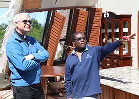 Archbishop Paul Coakley and Fr. Oby Zunmas inspect damage at Holy Cross Catholic Church. Credit: Diane Clay/Sooner Catholic