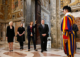 U.S. Secretary of State Mike Pompeo, his wife Susan, and Callista Gingrich, U.S. ambassador to the Vatican, listen to a tour guide as they visit the Sala Regia at the Vatican Oct. 2, 2019.