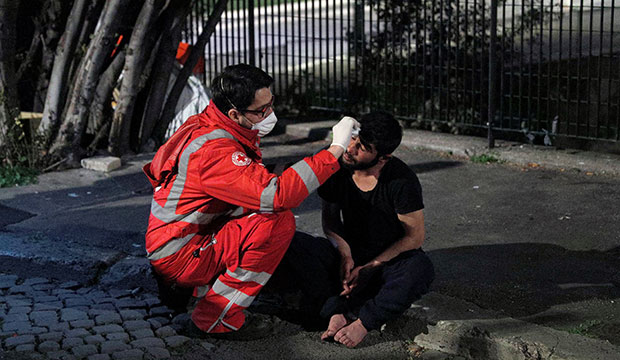 homeless person treated by red cross worker