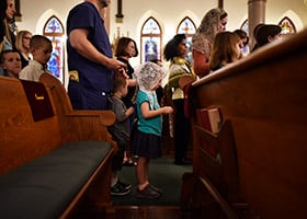 Christine Baird, 4, holds a rosary as she stands in line to visit the relic of St. Jean Vianney at St. Patrick Cathedral in Fort Worth, May 16, 2019. (NTC/Ben Torres)
