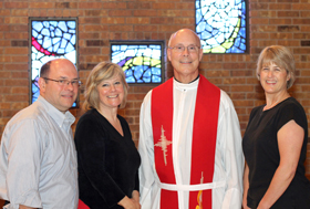 Deaf Ministry members, from left, LeRoy Terrio, Coordinator Connie Martin, Chaplain Fr. Ken Robinson, and choir director and religious education teacher Ann Rodenberg.