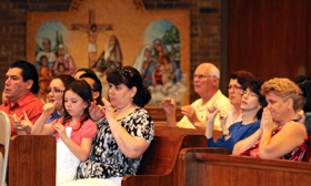 Catholics take an active part in all aspects of the monthly Deaf Community Mass, including responsorials.