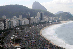 Pilgrims pack Copacabana beach for the World Youth Day closing Mass in Rio de Janeiro July 28. In attendance was an estimated 3 million people -- one of the largest crowds in the history of World Youth Day. (CNS photo/Stefano Rellandini, Reuters)