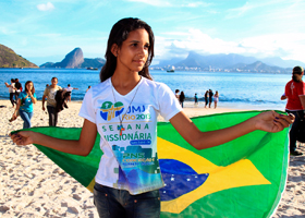 A young woman takes part in a World Youth Day countdown event along the beach in Rio de Janeiro in this photo from May. Brazil is set to host tens of thousands of young people for World Youth Day July 23-28. Pope Francis has approved a special indulgence for those who attend the event's liturgies and prayer services or for those who follow the events online in the spirit of prayer and contrition. (CNS photo/courtesy of World Youth Day Rio 2013)