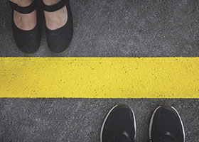 Feet at a yellow line