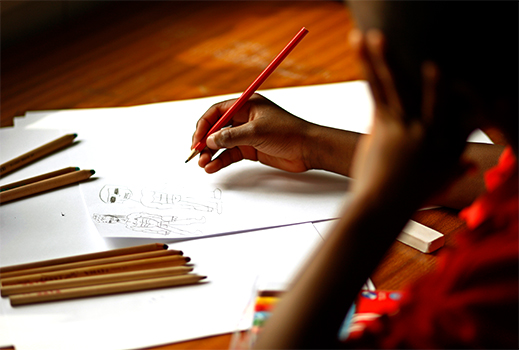 A child is pictured drawing during a therapy session. (CNS photo/Dylan Martinez, Reuters)