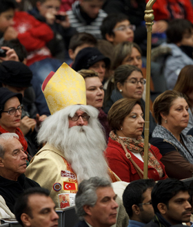 A man dressed as St. Nicholas attends Pope Benedict XVI's general audience in Paul VI hall at the Vatican Dec. 5. (CNS photo/Paul Haring)