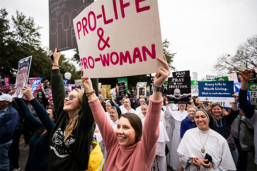 Isabella Padula and Genevieve Manning (left) cheer during the 2020 Texas Rally for Life Jan. 25 at the Texas Capitol. (NTC/Juan Guajardo)