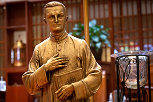 A statue of Father Michael McGivney, the founder of the Knights of Columbus, stands before the altar at St. Andrew Catholic Church as knights from across the diocese gather to celebrate the beatification of Fr. McGivney on October 31, 2020. (NTC/Rodger Mallison)