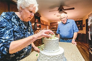 Betty Rose Walterscheid adds the finishing touches to a cake