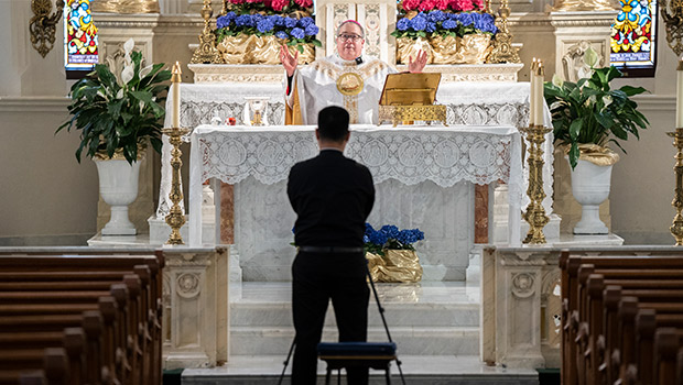 Bishop Michael Olson celebrates daily Mass April 28 at St. Patrick Cathedral. Deacon Linh Nguyen livestreamed the Mass to Facebook Live. (NTC/Juan Guajardo)
